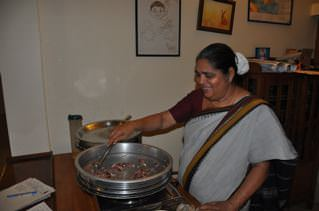 Kerala woman cooking food