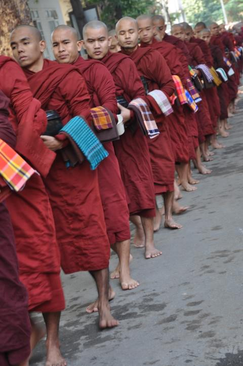 Monks at lunchtime, Mandalay, Burma