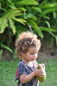 girl eating fruit in Fiji