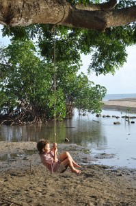 girl on a swing in Fiji