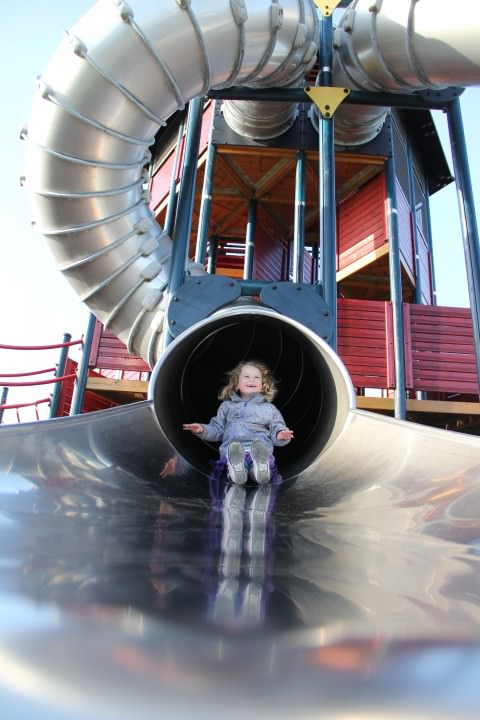 girl on slide in Denmark