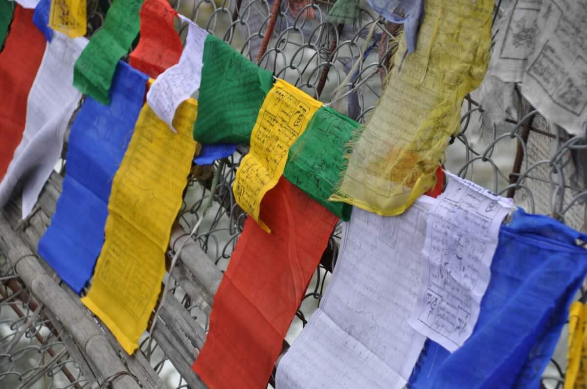 buddhist flags flying in bhutan