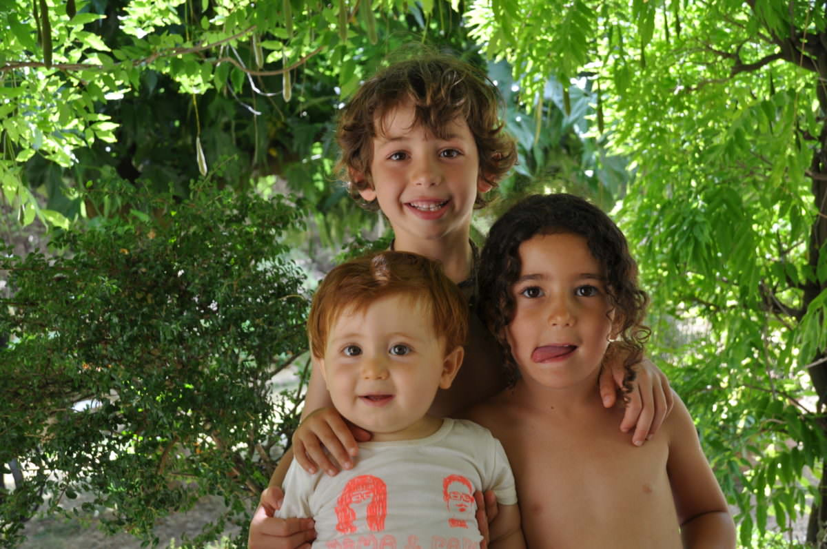 smiling friends under greens