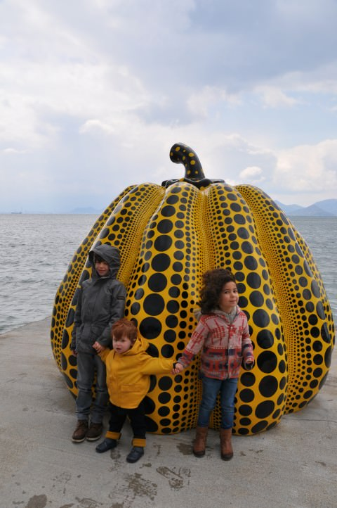 children by Yayoi Kusama's pumpkin in Japan