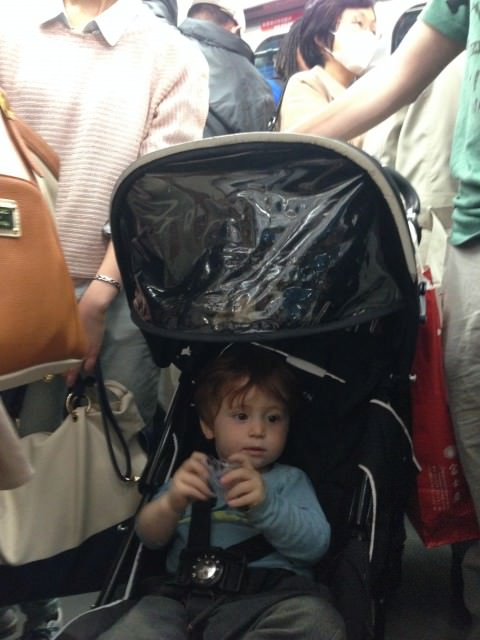 boy in stroller in Tokyo