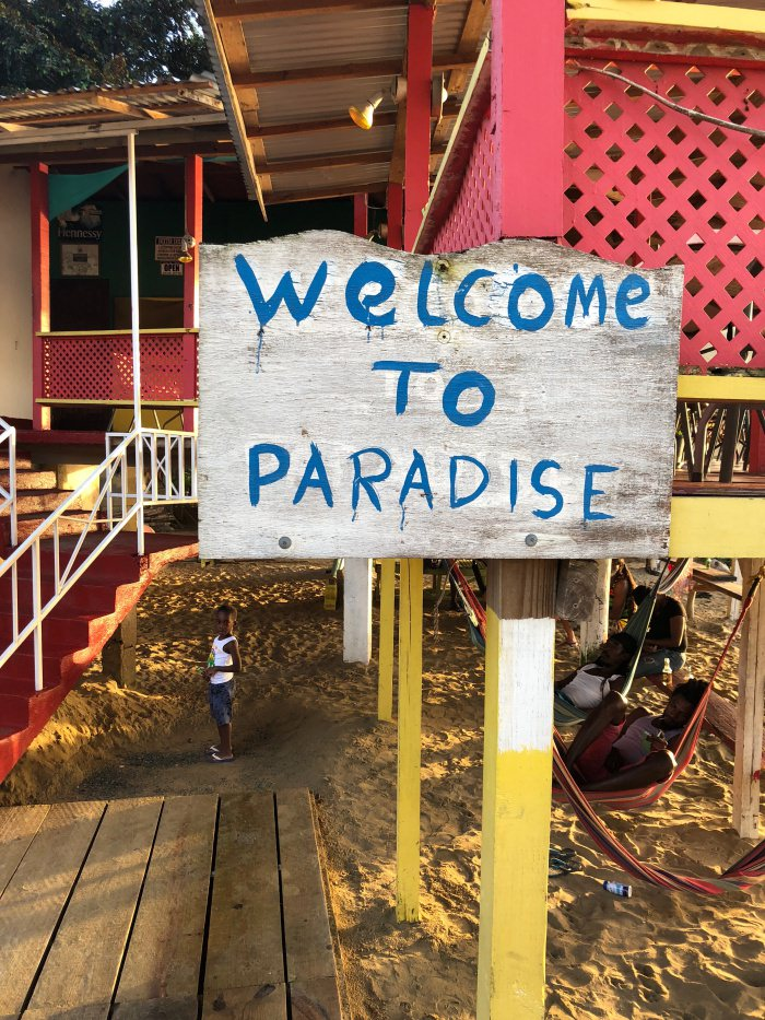 sign welcome to paradise on the beach, Tobago