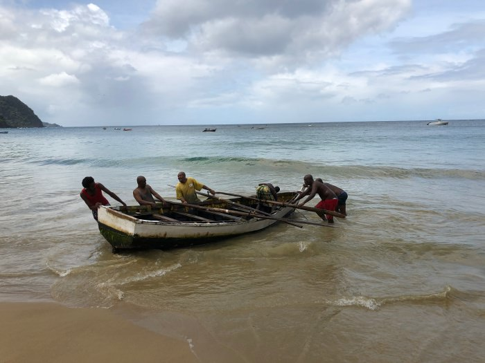 fishermen back on the beach in Castara Community