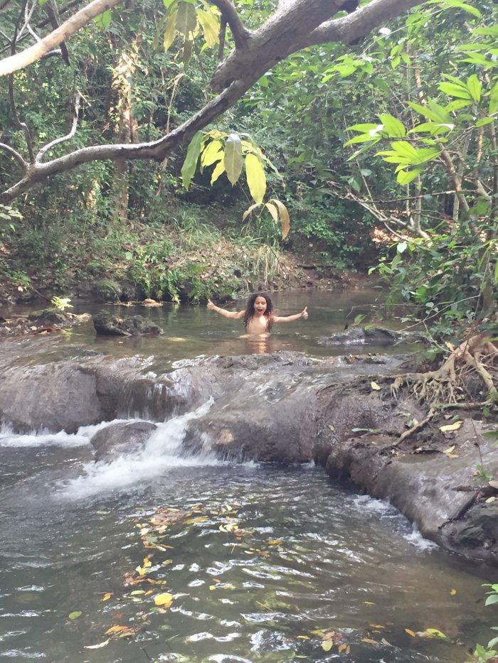 girl playing in river Sri Lanka