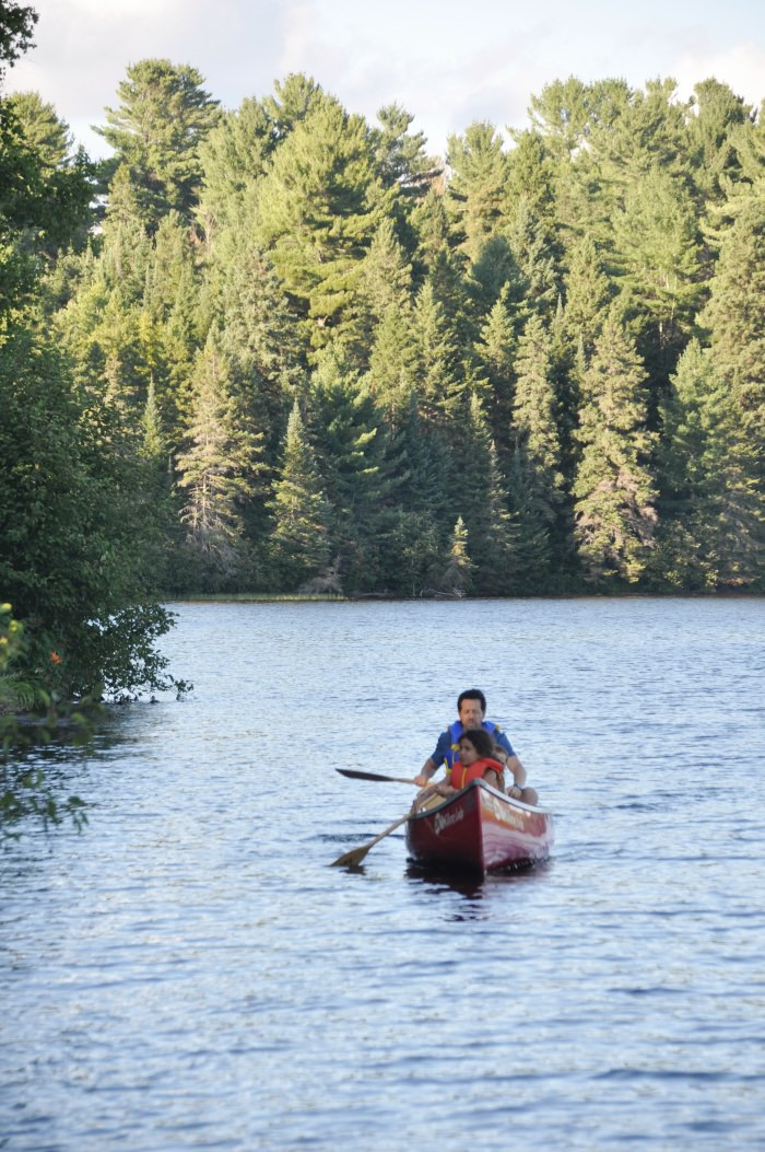 canoeing in the calm of the Algonquin Park Lake of Two Rivers