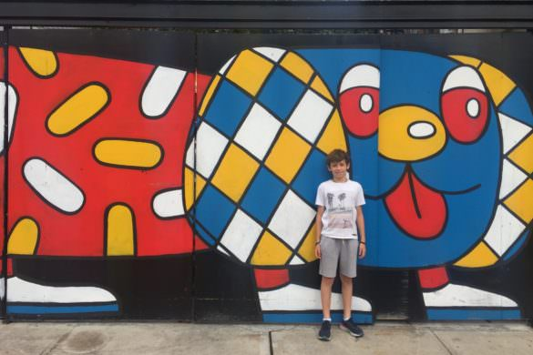 12 year old posing in front of graffiti wall in brooklyn