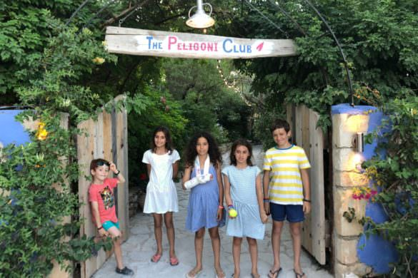 children in front of Peligoni Club entrance